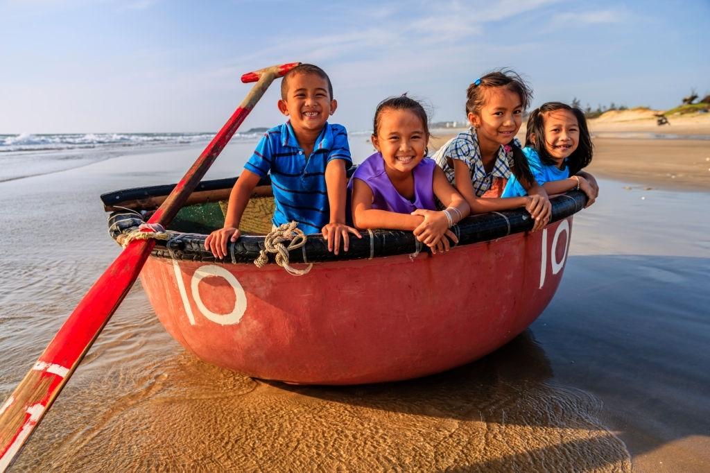 group-of-happy-vietnamese-children-have-fun-on-the-beach-vietnam